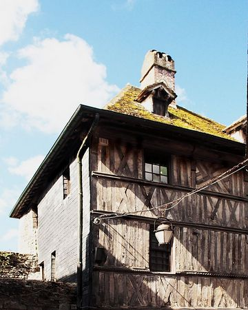 Honfleur, France - This building is an example of the mortar and beam construction. Notice the grass on the roof.