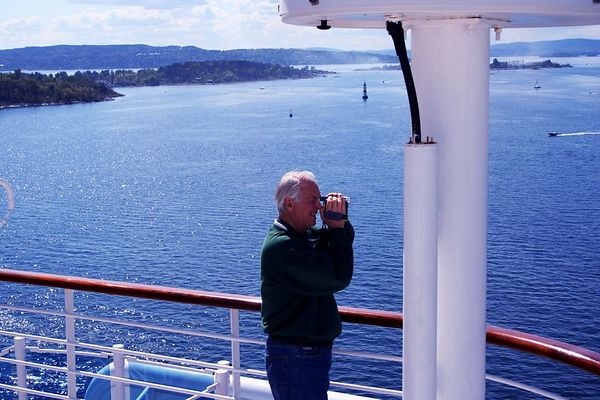 Jack is taking in the view with the video camera as we navigate down the fjord leaving Oslo