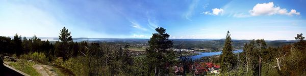 This panorama was made from four photos. It shows part of Oslo and the Oslofjord. It was taken from Ekberg Viewpoint at the top of Holmenkollen Hill, the site of the 1952 Olympic ski jumping competition.