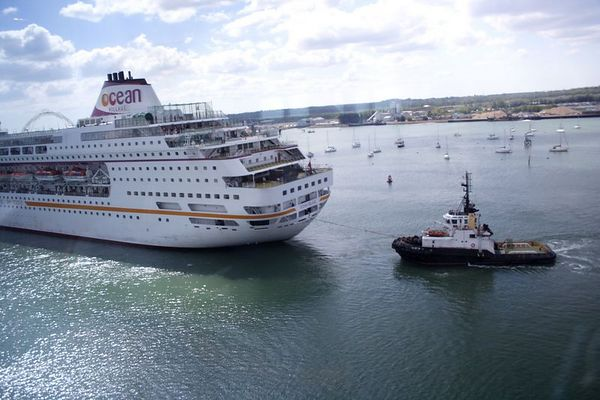 A side view of the Ocean Village Cruise ship being towed.