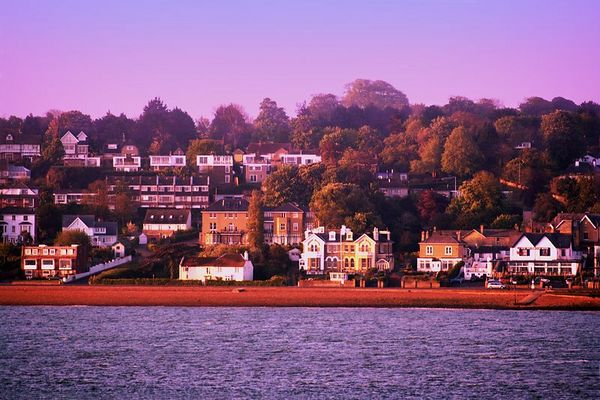 Beautiful homes line the waterway as we enter the harbor at Southampton. The morning sun is still casting a golden glow.