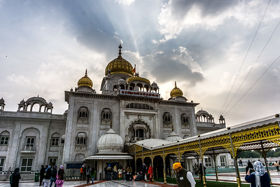 Gurudwara Bangla Sahib is one of the most prominent Sikh gurdwara, or Sikh house of worship, in Delhi. As with all Sikh Gurdwaras, the concept of langar is practiced, and all people, regardless of race or religion may eat in the Gurdwara kitchen (langar hall). The Langar (food) is prepared by gursikhs who work there and also by volunteers who like to help out. At the Gurdwara, visitors are requested to cover their hair and not to wear shoes.
