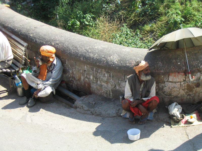 Beggars near the bridge.