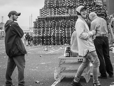 Sandy Row, Belfast. 11th night bonfire. Council inspector checking the height of the stack