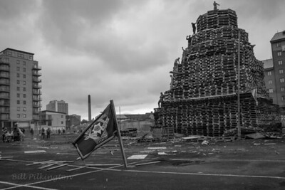 Sandy Row, Belfast. 11th night bonfire. Ulster freedom fighters flag.