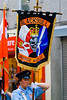 Flag bearer for the Blackskull Orange and blue marching in a traditional orange march in Dromore, Northern Ireland