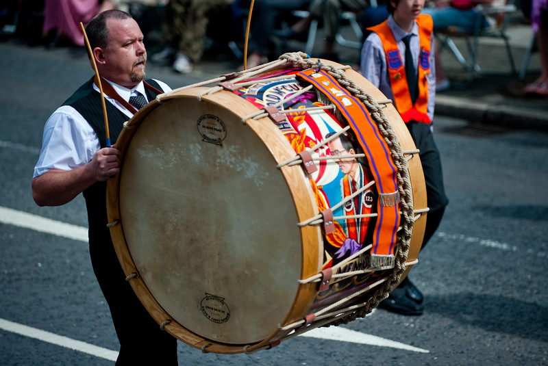 A lambeg drummer for LOL 123 during the annual 12th of July Orange Order march through Waringstown, County Down, Northern Ireland