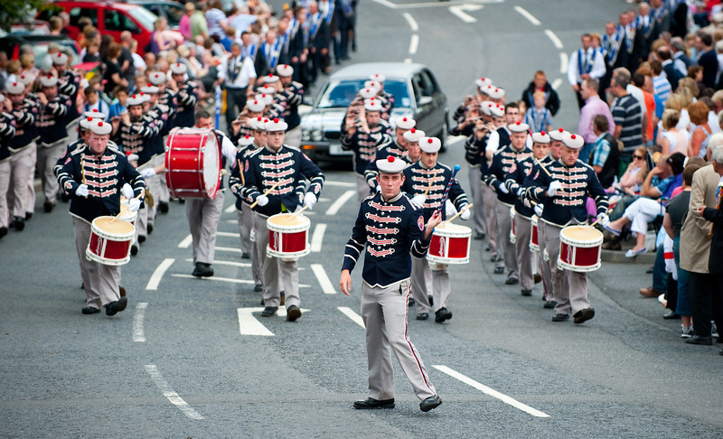 The band leader from the Clogher Protestant Boys Band displays his skill with the baton during the annual 12th of July Orange Order march through Waringstown, County Down, Northern Ireland 2