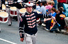 The band leader from the Clogher Protestant Boys Band displays his skill with the baton during the annual 12th of July Orange Order march through Waringstown, County Down, Northern Ireland