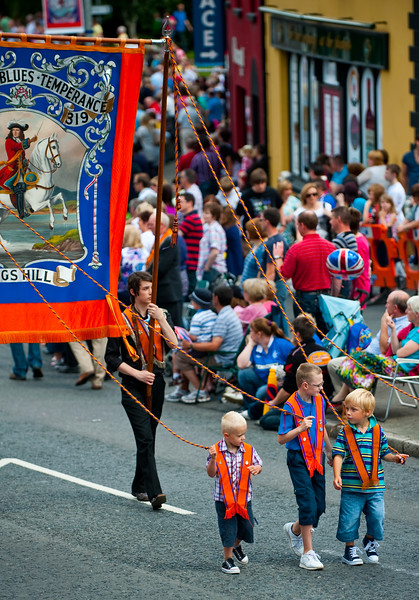 Young children guide a traditional banner from the Beers True Blues LOL 319, calling for temperance during the annual 12th of July Orange Order march through Waringstown, County Down, Northern Ireland