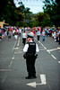 A member of the PSNI awaits the start of  the annual 12th of July Orange Order march through Waringstown, County Down, Northern Ireland