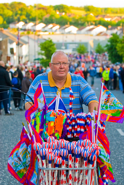 A vendor sells a colourful range of loyalist flags and souvenirs at the annual band parade Market Hill, County Armagh, Northern Ireland