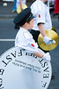 A child carries the spare drum skin during the traditional orange march in Donaghcloney, Northern Ireland