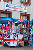 A well placed street stall sells a colourful range of loyalist flags and souvenirs at the annual band parade, Market Hill, County Armagh, Northern Ireland