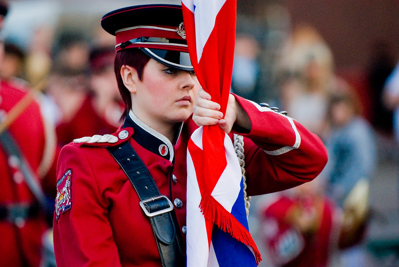 Flag bearer in taking part in a traditional orange march in Donaghcloney, Northern Ireland 2