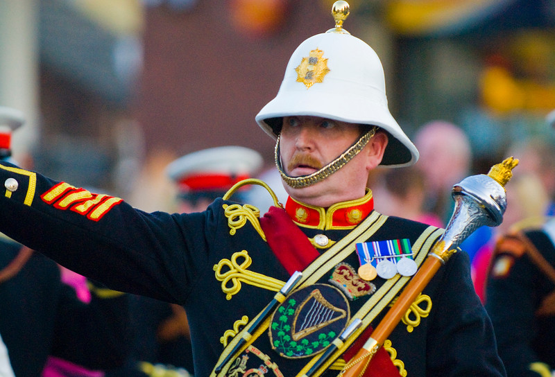A band leader in traditional military style uniform leads his band, marching in a traditional orange march in Dromore, co Down, Northern Ireland