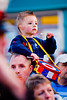 A young boy enjoys the view of the annual band parade Market Hill County Armagh Northern Ireland