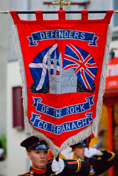 Flag bearer for the Defenders of the Rock County Fermanagh, marching in a traditional orange march in Dromore, Northern Ireland