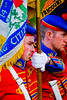 Flag bearer in taking part in a traditional orange march in Donaghcloney, Northern Ireland