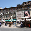 Verona - Piazza Erbe and some of the mid-day activity (note the elaborate designs on the sides of the buildings).