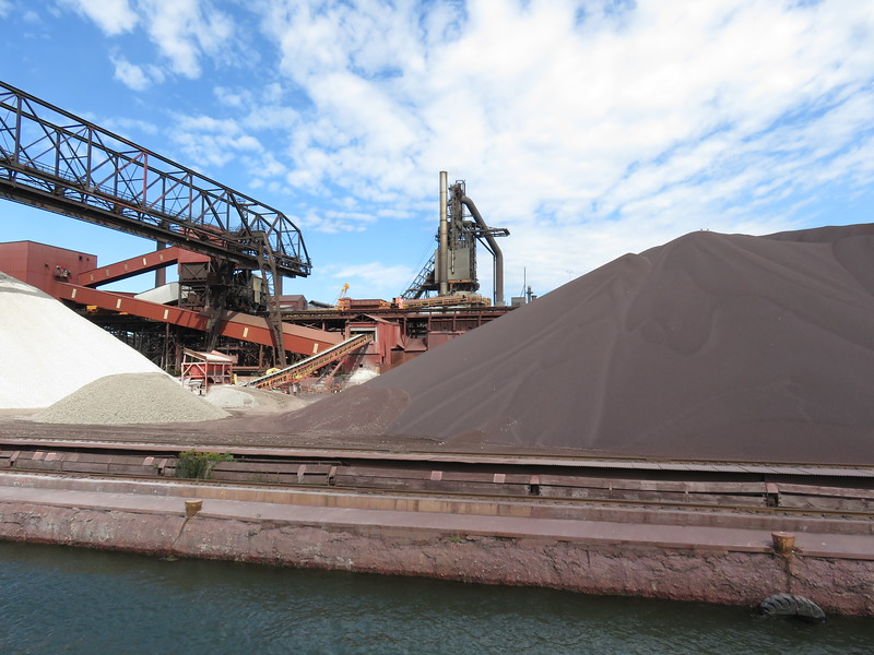 Piles of taconite ore at the steel mill on the Canadian side of the Soo Locks.