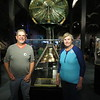 Dick and Susan with the bell of the Edmund Fitzgerald in the Great Lakes Shipwreck Museum at Whitefish Point