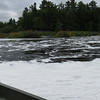 Rowing through river foam to the island at the Lower Falls