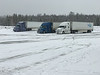Transport trucks in light snow at North Bay Petro Canada truck stop 2019 March 30