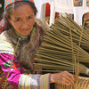 Woman with incense for sale - Can Cau Market