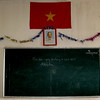 Than Kim Primary School - blackboard with Vietnam flag and Uncle Ho