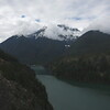 Diablo Lake with Colonial Peak partly obscured by clouds.