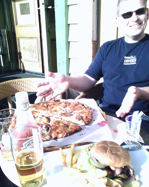 Jason gets his pizza!! <br /> <br /> met Jason on the ferry at Stavanger while waiting by the bikes to leave the ferry