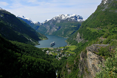 This was taken along the road above Geirangerfjord after we had left Mt. Dalsnibba. This is in central Norway in late June of 2012. Our cruise ship looks small but it is 951 feet long.