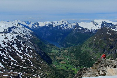 Geirangerfjord as seen from the top of Mt. Dalsnibba, over 4800 feet above the fjord. Weather was ordered up to perfection, and the solo stranger wearing the red jacket is straight out of the landscape photography instructional books.
