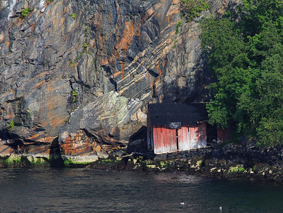 Check out the nice rock colors on this wall near Bergen. Many weathered boat sheds dotted the shores of the waterways. There were plenty of shiny ones too, but my weakness is the older ones that have not seen a paint brush in a while.