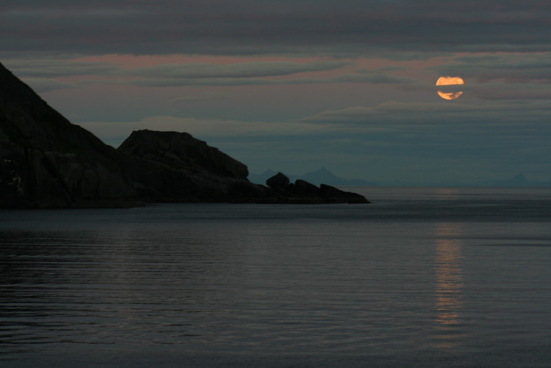 View from our Rorbu (fisherman's cabin) in Nusfjord.  Moon rising - sky still pretty bright at 9:44pm