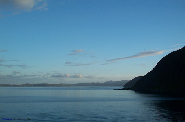 Approaching North Cape. The sky and sea are blue. Norway.
