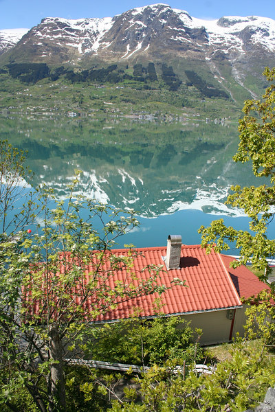 View of our Hovland cottage on the shores of the Sorfjord with the Folongafel Glacier lurking on the peaks above.