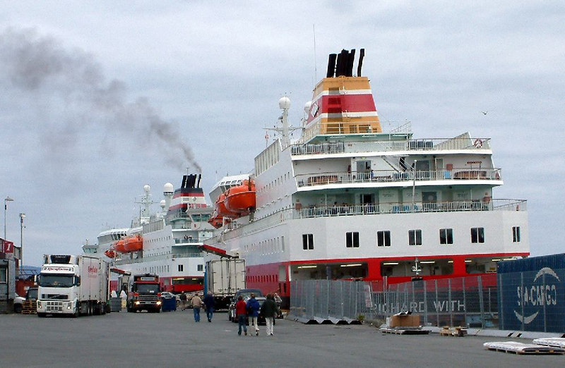 "Two modern Norwegian hurtigruten ships, motor vessels Richard With (south bound) and Nordlys (northbound), at Trondheim, June 2006 - the world famous hurtigruten service between Bergen and Kirknes at the North Cape has been running for over a century.<br /> <br /> The vessels have the same hull colours but different funnel liveries. The Richard With (nearest) has the traditional funnel colours of the Ofotens og Vesteraalens Dampskibselskab (the Ofoten & Vesteralen Steamship Company). This company resulted from the merger in 1988 of Vesteraalens Dampskibsselskab (founded 1881) and Ofotens Dampskipsselskap (founded 1936) The Nordlys bears the red, white and black funnel livery of Troms Fylkes Dampskibsselskap (founded in 1866). These two old companies are now merged (since 1st March 2006) as the Hurtigruten Group ASA.<br /> <br />  <a href=""http://www.hurtigruten.co.uk/MSrichardwith.asp"">http://www.hurtigruten.co.uk/MSrichardwith.asp</a><br /> <br />  <a href=""http://www.hurtigruten.co.uk/MSnordlys.asp"">http://www.hurtigruten.co.uk/MSnordlys.asp</a>"