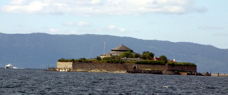 Monks Island in the fjord off Trondheim with the fast cat leaving to come into Trondheim harbour