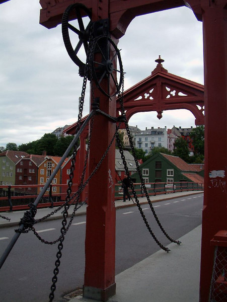 Bybrua - the old bridge over the River Nidar - at one time the part between the two arches lifted allow high masted ships to pass. The lifting chains and pulleys are simulated. e