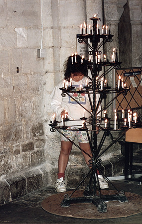 Lan lighting candle Norwich cathedral Norwich England - Jun 1996