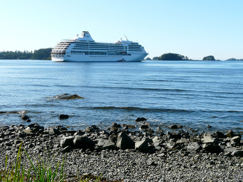 A ship anchors in Sitka Sound as cruise guests take tours in Sitka Alaska.