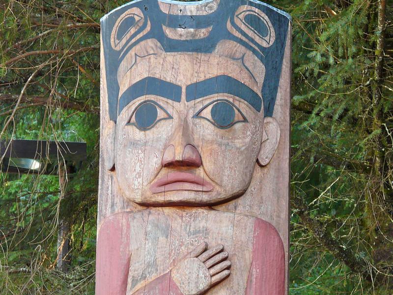 Totem pole on a totem walk at Sitka, Alaska.