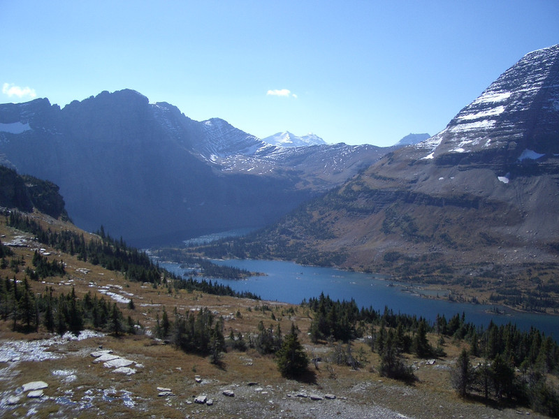 Mountain terrain beyond the blue waters of Hidden Lake in Glacier National Park.