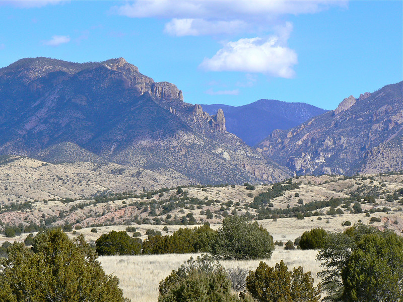rocky landscape with mountains in the background on a New Mexico backroads trip