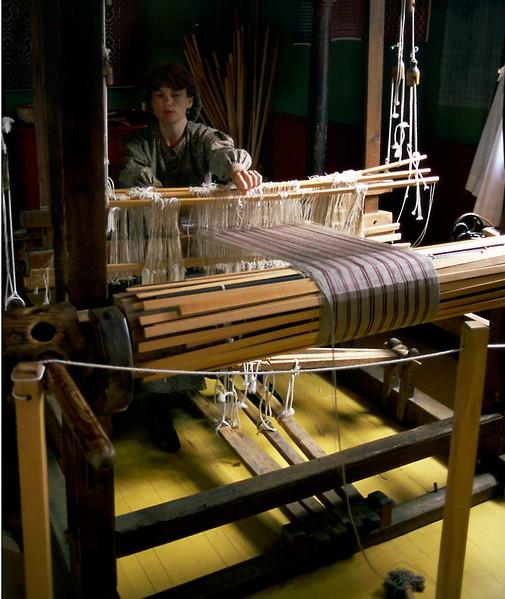 Weaver and loom, Sherbrooke Village, Nova Scotia, 8/04