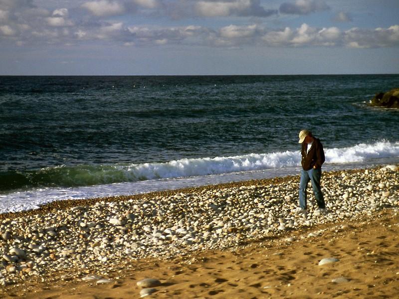 Rita on cobble beach near Pleasant Bay, Cape Breton Island, Nova Scotia, 8/04