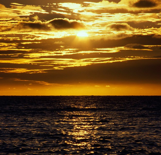 Sunset over ocean near Pleasant Bay, Cape Breton Island, Nova Scotia, 8/04