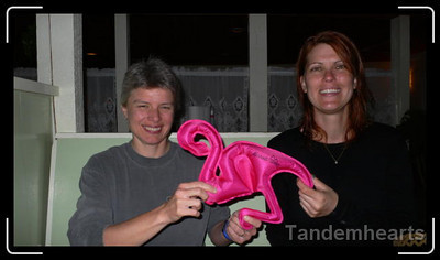 Carol (aka Traveler 62), Rose (the flamingo) and Cindy at dinner in Bar Harbor.